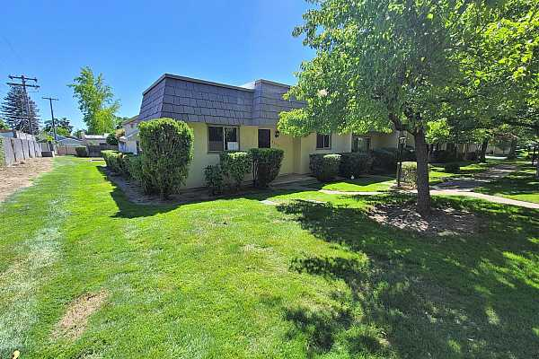 Photo #4 Beautiful Front Yard Space and Landscape, all maintained by the HOA!