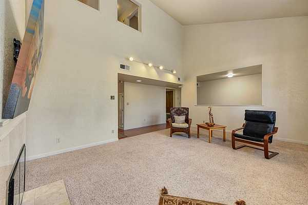 Photo #7 View of the living room with vaulted ceilings.