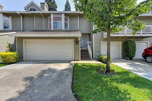 Photo #1 Lovely front view of this 1310 sf- 2 Car garage Townhome in Cirby Hills.