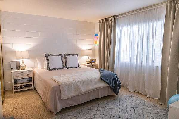 Photo #1 Wake up to very gentle rays of sunshine peeking through the trees just outside your east-facing bedroom window! Because the unit faces south, you enjoy lots of beautiful natural light that brightens dreary winter days yet is not too hot during Sacramento summers!