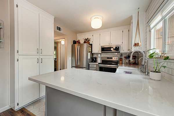 Photo #8 Fully remodeled kitchen completed in 2020 with Quartz countertops and stainless steel appliances.