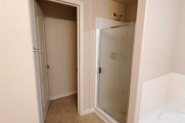 Photo #10 Master bathroom with brand new shower door and rainfall shower head