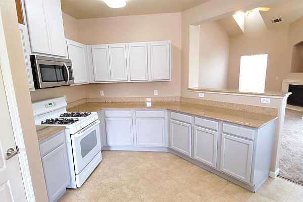 Photo #5 Kitchen with updated cabinets and stainless steel appliances