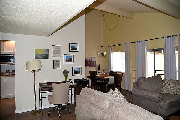 Photo #9 living room and breakfast nook with vaulted ceiling