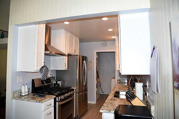 Photo #7 view of kitchen and access to laundry room