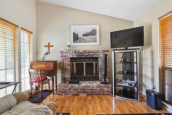 Photo #6 Livingroom allows for lots of light along with a Cozy Fireplace
