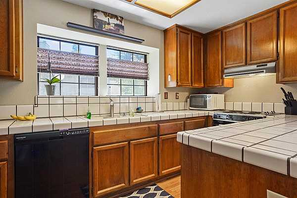 Photo #12 Nice sized Kitchen with beautiful cabinets, lots of counter space and beautiful flooring. Dishwasher has hardly ever been used.