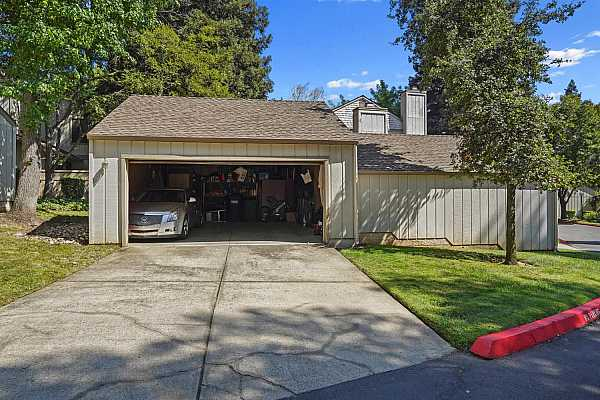Photo #4 Nice sized two car garage with long driveway
