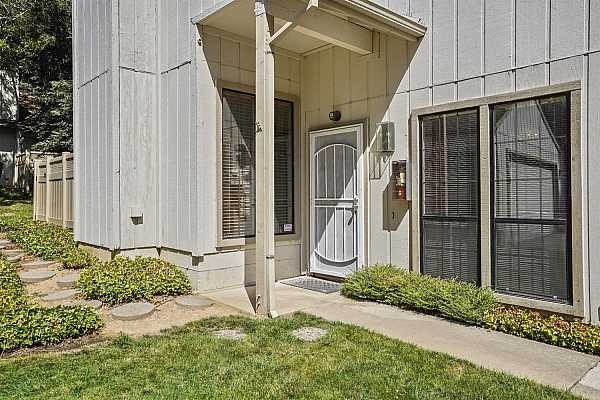 Photo #2 Desirable  lower level condominium located in a park like community