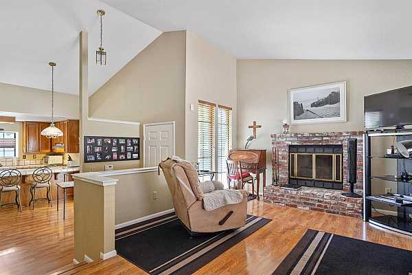 Photo #5 Bright & Open with Vaulted Ceiling, Custom Paint, Beautiful laminate Flooring & Cozy Fireplace