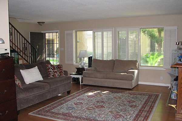 Photo #2 A large living room with plantation shutters.