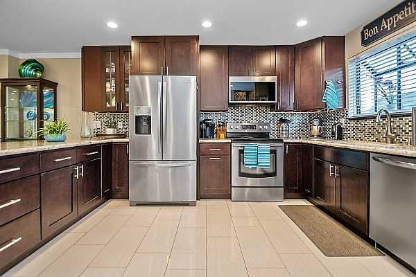 Photo #3 Cherrywood cabinets and beautiful backsplash complete the sleek look of this kitchen!