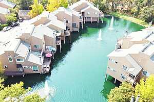 Browse active condo listings in ARCADE LAKES