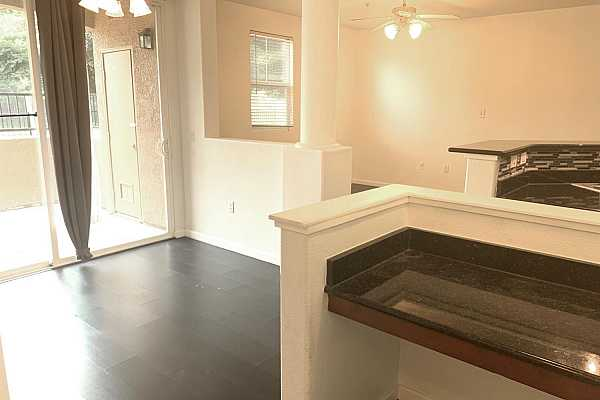Photo #6 Dinning room with patio access. Built in workspace with granite countertop.