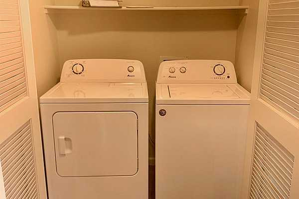 Photo #9 Indoor laundry with washer and dryer included in sale.