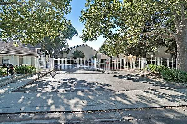 Photo #10 Southland Village a gated community with the entrance being off of Gloria Drive.