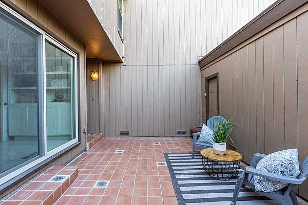 Photo #4 Your spacious private courtyard with Mexican terra cotta tile.