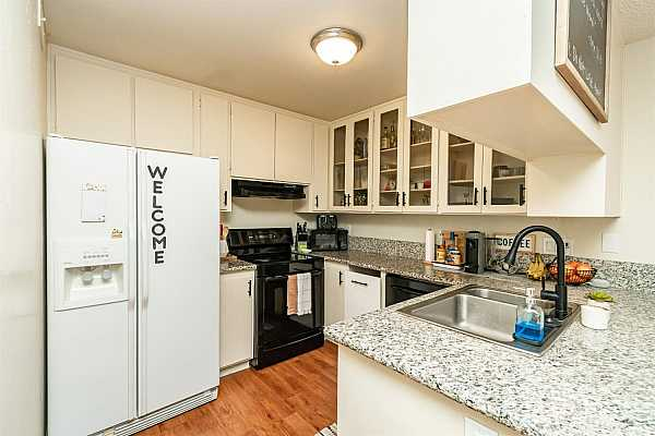 Photo #12 Electric stove/range. Newer kitchen faucet. Clear front cabinetry to display your style!