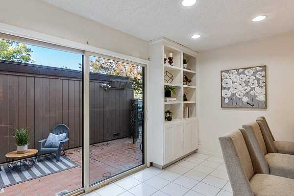 Photo #7 Roomy breakfast nook with built in cabinets.
