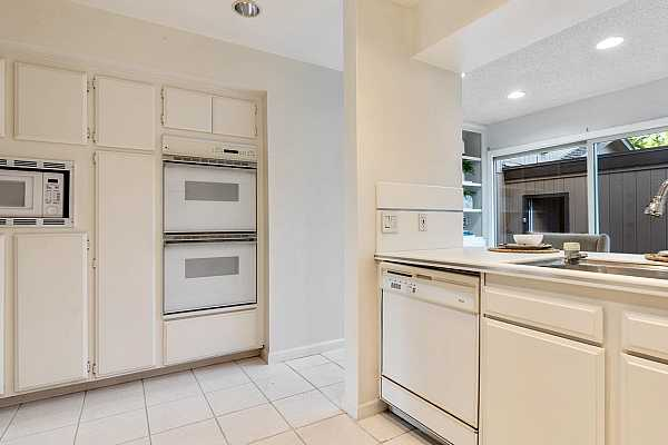 Photo #11 Couble ovens and built in microwave plus plenty of cabinet storage space.